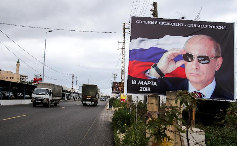 Vladimir Putin, seen here on a billboard in south Lebanon, has stamped his total authority in Russia, silencing opposition and reasserting Moscow's lost might abroad (AFP Photo/Mahmoud ZAYYAT)