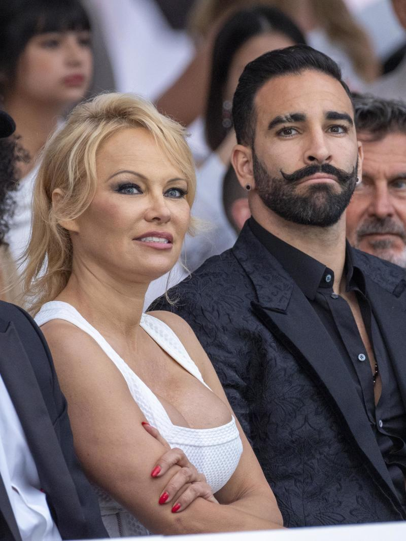 MONTE-CARLO, MONACO - MAY 24: (L-R) Pamela Anderson and Adil Rami attend Amber Lounge 2019 Fashion Show on May 24, 2019 in Monte-Carlo, Monaco. (Photo by Arnold Jerocki/Getty Images)