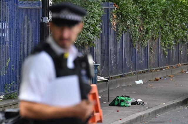A police officer guards the scene of a stabbing in Woolwich in London (Picture: PA)