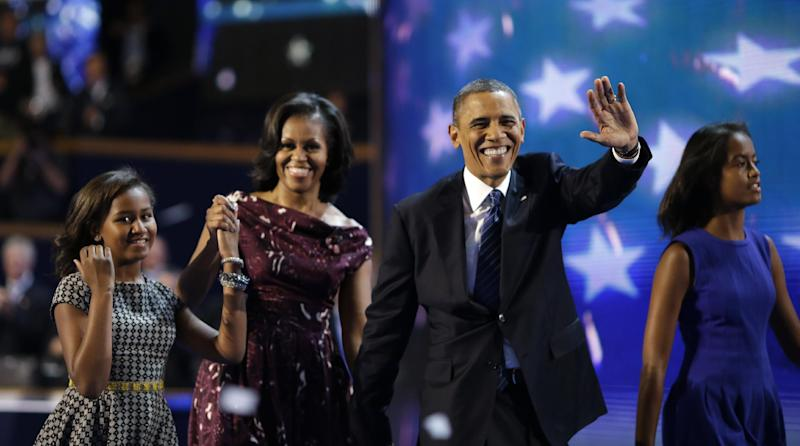 President Barack Obama and First lady Michelle Obama joined by their children Sasha, left, and Malia walks across the stage after President Obama's speech to the Democratic National Convention in Charlotte, N.C., on Thursday, Sept. 6, 2012. (AP Photo/David Goldman)