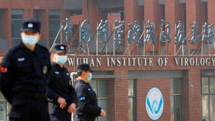 Security guards continue to monitor outside the Wuhan Institute of Vase