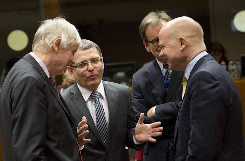 British Foreign Minister William Hague, right, speaks with from Finnish Foreign Minister Erkki Tuomioja, left, and Czech Republic's Foreign Minister Lubomir Zaoralek during a meeting of EU foreign ministers in Brussels on Monday, Feb. 10, 2014. EU foreign ministers on Monday will discuss how to help foster a political situation for the severe crisis that has engulfed Ukraine. The 28 ministers were also weighing the fallout of Sunday's referendum in Switzerland putting into question the free movement of citizens between the bloc and the Alpine nation. (AP Photo/Virginia Mayo)