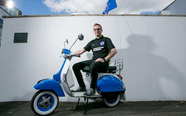 <span>Kevin Falconer owns a scooter shop and has had his own Vespa painted in the club's colours</span> <span>Credit: David McHugh for THE TELEGRAPH </span>