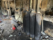 Burned oxygen cylinders are seen in the intensive care unit of the Ibn al-Khatib hospital following a fire that broke out of last Saturday evening killing over 80 people and injuring over 100, in Baghdad, Iraq, Tuesday, April 27, 2021. Medical staff who witnessed the first moments of a Baghdad hospital fire described horrific scenes: deafening screams, a patient who jumped to his death to escape the inferno and relatives who died because they refused to abandon coronavirus patients tethered to ventilators. (AP Photo/Khalid Mohammed)