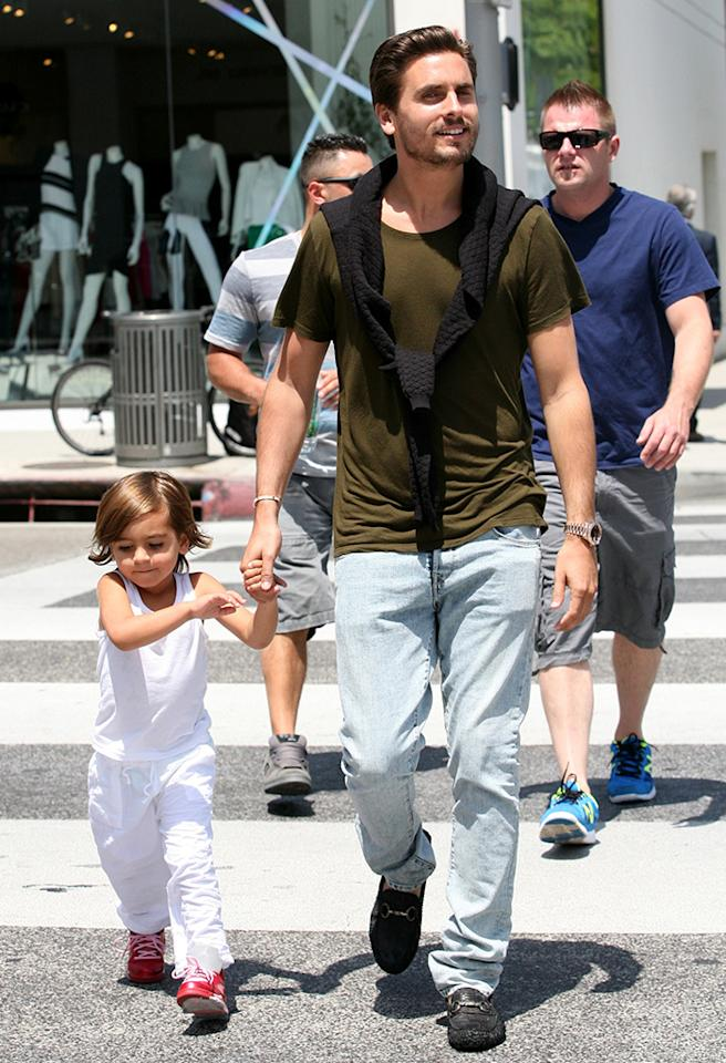 Scott Disick and son are all smiles leaving Il Pastio restaurant in Beverly Hills, CA