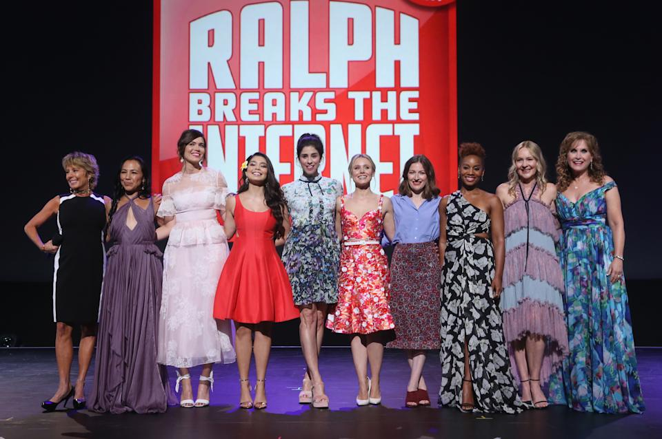 ANAHEIM, CA - JULY 14:  (L-R) Actors Paige O'Hara (Belle/BEAUTY AND THE BEAST), Irene Bedard (POCAHONTAS), Mandy Moore (Rapunzel/TANGLED), Auli'i Cravalho (MOANA), Sarah Silverman (Vanellope von Schweetz/RALPH BREAKS THE INTERNET: WRECK-IT RALPH 2), Kristen Bell (Anna/FROZEN), Kelly Macdonald (Merida/BRAVE), Anika Noni Rose (Tiana/THE PRINCESS AND THE FROG), Linda Larkin (Jasmine/ALADDIN), and Jodi Benson (Ariel/THE LITTLE MERMAID) of RALPH BREAKS THE INTERNET: WRECK-IT RALPH 2 took part today in the Walt Disney Studios animation presentation at Disney's D23 EXPO 2017 in Anaheim, Calif. RALPH BREAKS THE INTERNET: WRECK-IT RALPH 2 will be released in U.S. theaters on November 21, 2018.         (name of talent) of (name of film) took part today in the Walt Disney Studios animation presentation at Disney's D23 EXPO 2017 in Anaheim, Calif. (name of film) will be released in U.S. theaters on (release date).  (Photo by Jesse Grant/Getty Images for Disney)