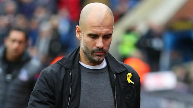The former Barcelona and Bayern Munich boss has rarely appeared without the symbol attached to his garment in recent months, but what does it mean?
