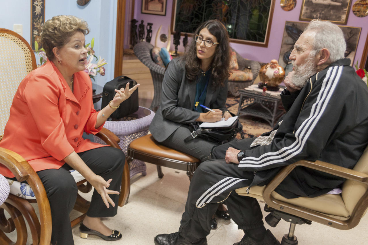 In this photo released by Cubadebate on its website, Brazil's President Dilma Rousseff, left, visits with Cuba's former President Fidel Castro in Havana, Cuba, Monday, Jan. 27, 2014. Rousseff is in Havana to attend the Community of Latin American and Caribbean States summit. (AP Photo/Cubadebate, Alex Castro)