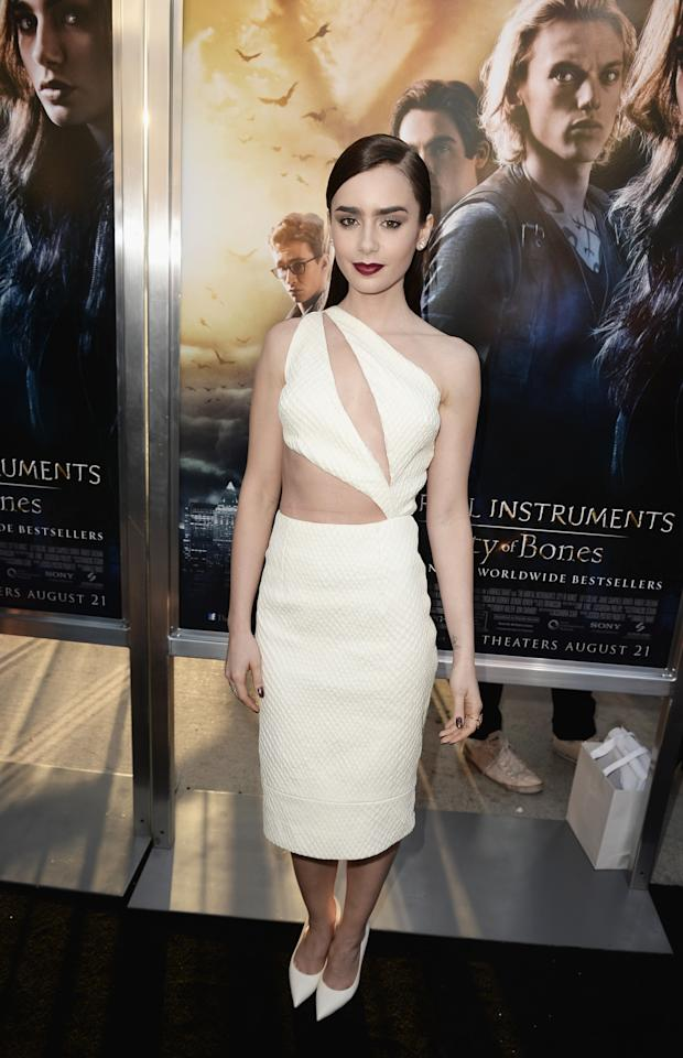 """HOLLYWOOD, CA - AUGUST 12: Actress Lily Collins attends the premiere of Screen Gems & Constantin Films' """"The Mortal Instruments: City of Bones"""" at ArcLight Cinemas Cinerama Dome on August 12, 2013 in Hollywood, California. (Photo by Kevin Winter/Getty Images)"""