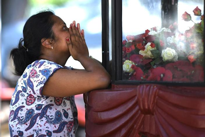 A woman prays at St Sebastian's Church in Negombo a day after the church was hit by a suicide bomber (AFP Photo/Jewel SAMAD)