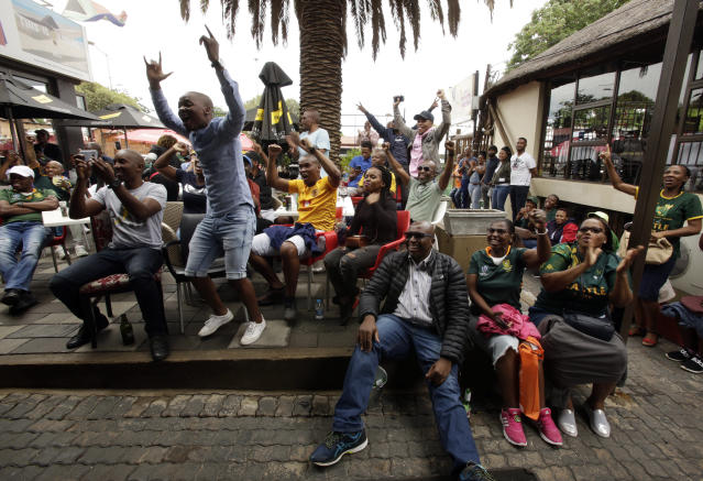 South African fans celebrate at Vilakazi street in Soweto, South Africa, after their team's victory in the Rugby World Cup final between South Africa and England being played in Tokyo, Japan from Saturday Nov. 2, 2019. South Africa defeated England 32-12. (AP Photo/Themba Hadebe)