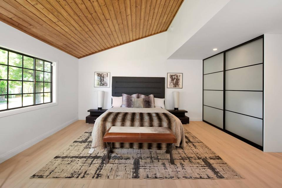 """<div class=""""caption""""> Wood ceilings and floors can be found throughout the home. </div> <cite class=""""credit"""">Courtesy of Tim Gavin Real Estate</cite>"""