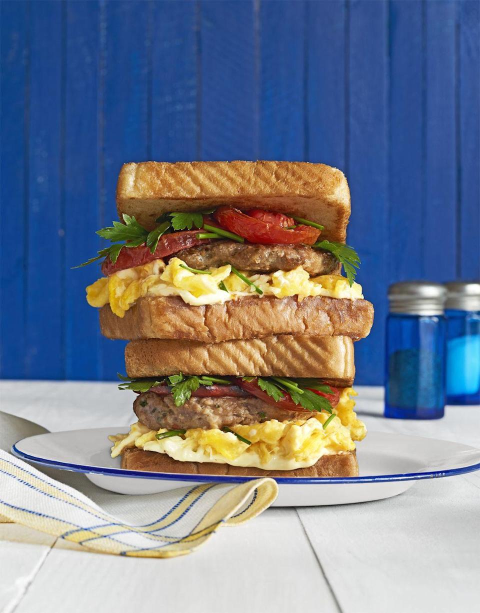 """<p>The best cure to the early morning blues? Big ol' egg sandwiches. </p><p><em><a href=""""http://www.countryliving.com/food-drinks/recipes/a41634/loaded-breakfast-sandwiches-recipe/"""" rel=""""nofollow noopener"""" target=""""_blank"""" data-ylk=""""slk:Get the recipe from Country Living »"""" class=""""link rapid-noclick-resp"""">Get the recipe from Country Living »</a></em></p>"""