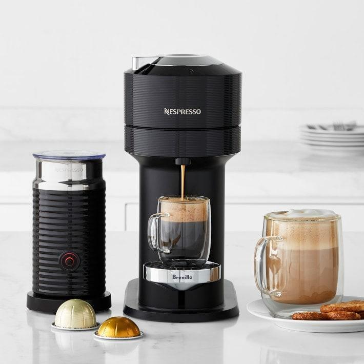 """Busy moms who need a cup of joe to feel like it's today can finally get their caffeine fix with zero prep (or cleanup). The Vertuo Next also stands out from other Nespresso models since it's made with 54% recycled materials. $330, Williams Sonoma. <a href=""""https://www.williams-sonoma.com/products/nespresso-vertuo-next-classic-by-breville-with-aeroccino/?"""" rel=""""nofollow noopener"""" target=""""_blank"""" data-ylk=""""slk:Get it now!"""" class=""""link rapid-noclick-resp"""">Get it now!</a>"""