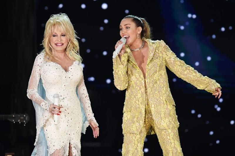 Dolly Parton and Miley Cyrus | Kevin Winter/Getty