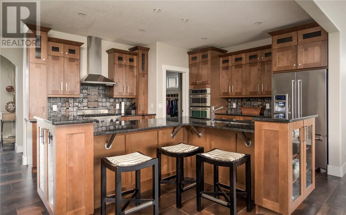 """<p><a rel=""""nofollow"""">209 Trillium Rd., Fort McMurray, Alta.</a><br /> The kitchen has built-in appliances, quartz countertops, soft-close drawers and cabinet lighting.<br /> (Photo: Zoocasa) </p>"""