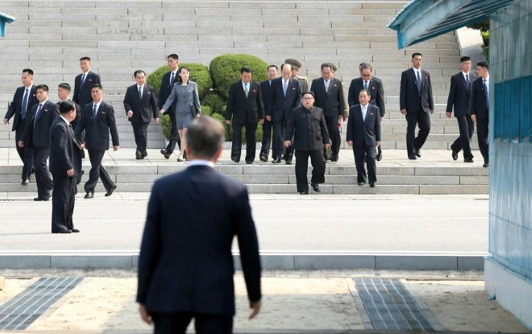 South Korea's President Moon Jae-in (front) waits before the Military Demarcation Line for North Korea's leader Kim Jong Un (centre R) ahead of the inter-Korean summit at the truce village of Panmunjom