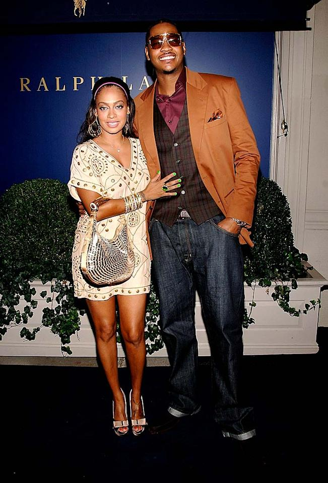"""Carmelo Anthony turns heads in this loud getup, and no one can miss LaLa Vasquez's lime green fingernails. They look like they glow in the dark! Jamie McCarthy/<a href=""""http://www.wireimage.com"""" target=""""new"""">WireImage.com</a> - September 10, 2008"""