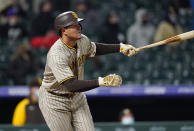 San Diego Padres' Manny Machado watches his three-run triple off Colorado Rockies relief pitcher Tyler Kinley during the sixth inning of a baseball game Tuesday, May 11, 2021, in Denver. (AP Photo/David Zalubowski)