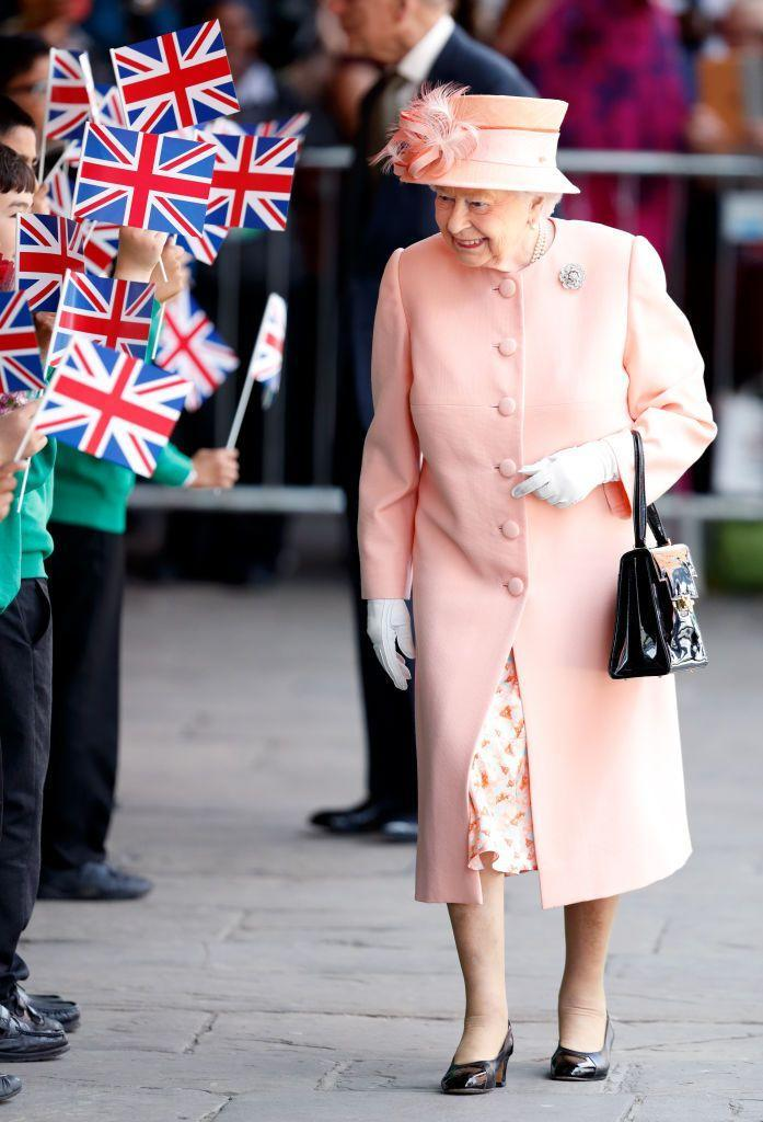 """<p>Queen Elizabeth selected a dreamy peach ensemble to mark the 175th anniversary of the first <a href=""""https://www.townandcountrymag.com/society/tradition/g12798355/royal-train/"""" rel=""""nofollow noopener"""" target=""""_blank"""" data-ylk=""""slk:train journey by a British monarch"""" class=""""link rapid-noclick-resp"""">train journey by a British monarch</a> in 2017, traveling the same railways her ancestor, Queen Victoria, first created. </p>"""