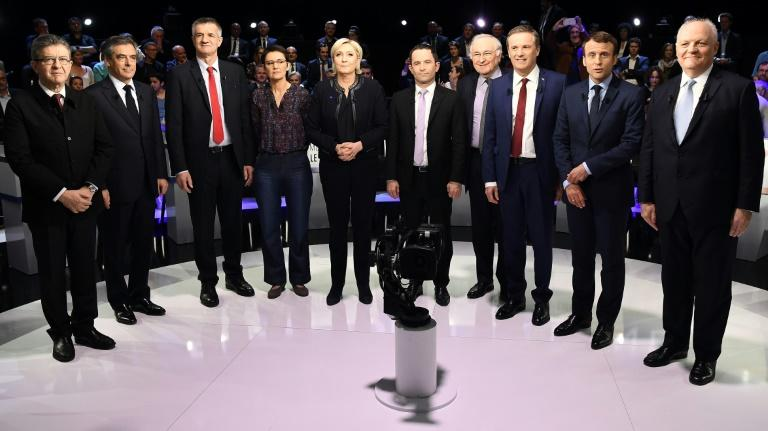 Ten of the eleven candidates before the debate -- autoworker Philippe Poutou refused to take part in the family photo