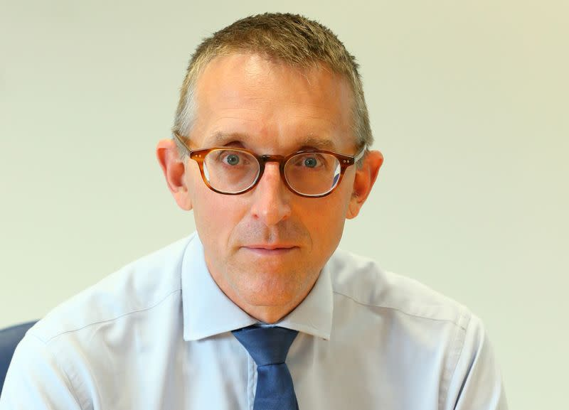 FILE PHOTO: Sam Woods head of Britain's Prudential Regulation Authority poses for a portrait in his office in London