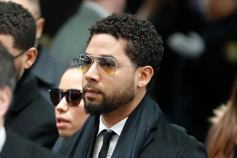 """Former """"Empire"""" actor Jussie Smollett, center, arrives for an initial court appearance Monday, Feb. 24, 2020, at the Leighton Criminal Courthouse in Chicago."""