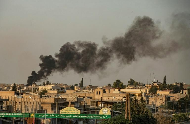 Smoke billows into the air following Turkish bombardment on Syria's northeastern Kurdish-held town of Ras al-Ain on October 9, 2019