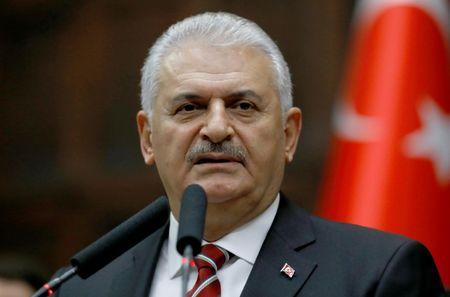 Turkey's Prime Minister Binali Yildirim addresses members of parliament from his ruling AK Party during a meeting at the Turkish parliament in Ankara