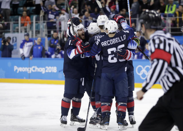 Players from the United States celebrate after Ryan Donato scores a goal against Slovakia during the third period of the preliminary round of the men's hockey game at the 2018 Winter Olympics. (AP)