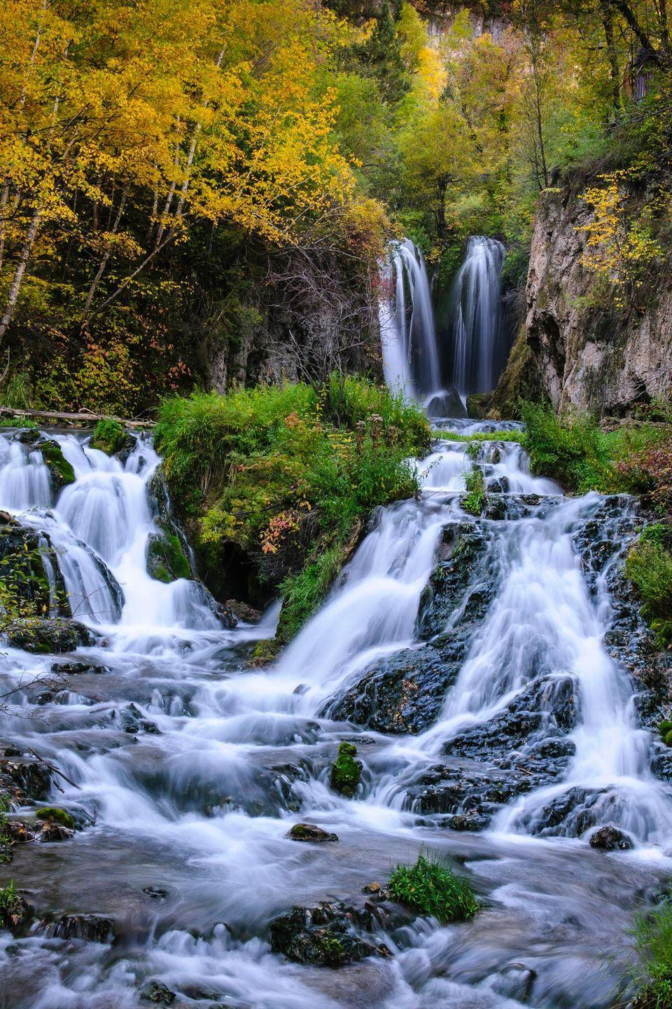 """<p><strong>The Drive: </strong><a href=""""https://www.tripadvisor.com/Attraction_Review-g54810-d1998098-Reviews-Spearfish_Canyon_Scenic_Byway-Spearfish_South_Dakota.html"""" rel=""""nofollow noopener"""" target=""""_blank"""" data-ylk=""""slk:Spearfish Canyon Byway"""" class=""""link rapid-noclick-resp"""">Spearfish Canyon Byway</a></p><p><strong>The Scene: </strong>Travel through one of the prettiest towns in South Dakota just off of Interstate 90. Come visit in the fall to see all the vibrant autumn colors in the canyon. </p><p><strong>The Pit-Stop: </strong>Walk to <a href=""""https://www.tripadvisor.com/AttractionsNear-g54810-d8559731-Bridal_Veil_Falls-Spearfish_South_Dakota.html"""" rel=""""nofollow noopener"""" target=""""_blank"""" data-ylk=""""slk:Bridal Veil Falls"""" class=""""link rapid-noclick-resp"""">Bridal Veil Falls</a>, where there's a small wooden platform that's a popular spot for Instagram-worthy photos.</p>"""