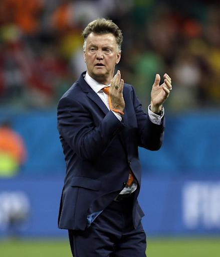 Netherlands' head coach Louis van Gaal applauds after the Netherlands defeated Costa Rica 4-3 in a penalty shootout after a 0-0 tie during the World Cup quarterfinal soccer match at the Arena Fonte Nova in Salvador, Brazil, Saturday, July 5, 2014. (AP Photo/Natacha Pisarenko)