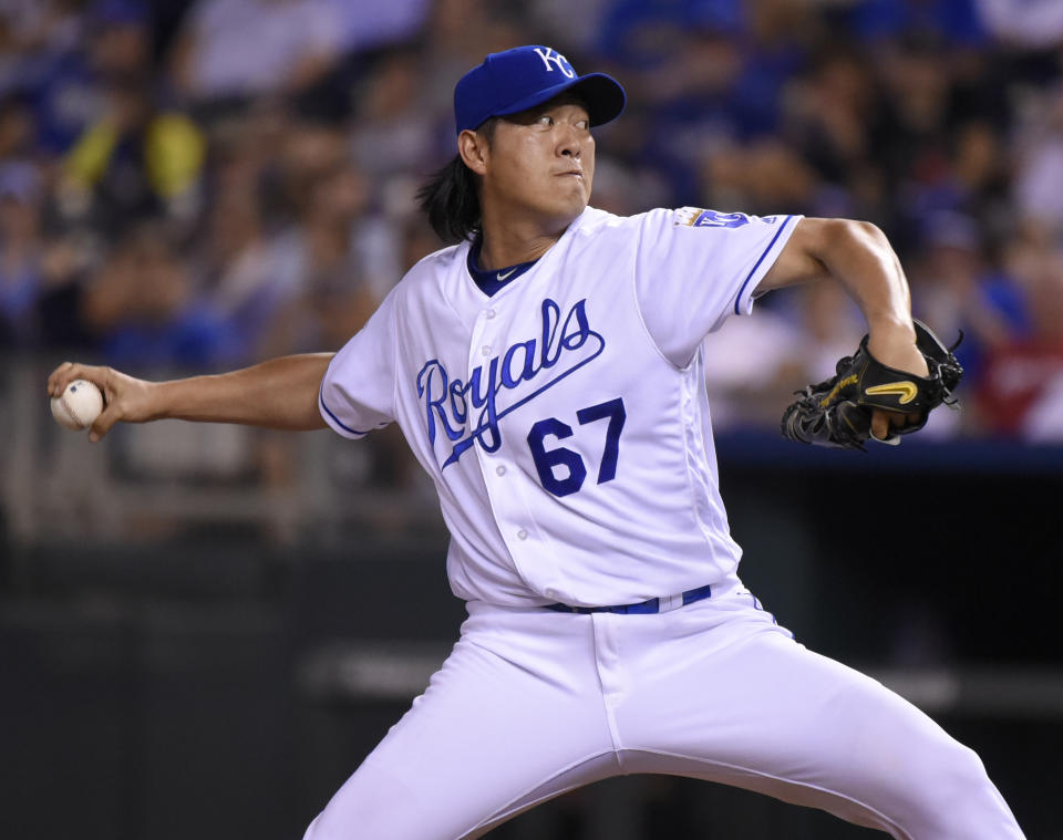 KANSAS CITY, MO - JULY 19:  Chien-Ming Wang #67 of the Kansas City Royals throws in the ninth inning against the Cleveland Indians at Kauffman Stadium on July 19, 2016 in Kansas City, Missouri. (Photo by Ed Zurga/Getty Images)