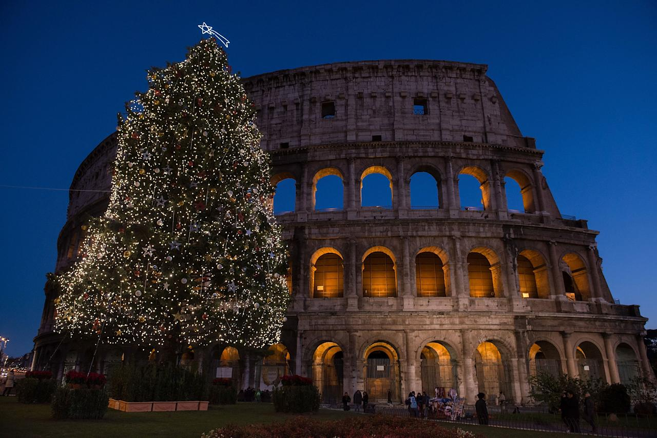 A Christmas tree stands illuminated in front of the Coliseum on December 9, 2012 in Rome, Italy.  (Photo by Giorgio Cosulich/Getty Images)