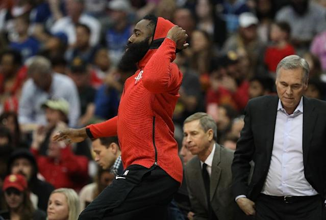 Even with MVP candidate James Harden sitting out with a sore left knee, the Rockets had little trouble from Dallas, clinching a playoff berth with a 105-82 rout (AFP Photo/RONALD MARTINEZ)