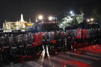 Red paint thrown by pro-democracy protesters is splattered on the road and on the shields of riot police standing guard outside the Grand Palace in Bangkok, Thailand, Saturday, Feb. 13,2021. The rally in the Thai capital was organized by the Ratsadorn movement, which campaigned last year for Prime Minister Prayuth Chan-ocha and his government to step down, the constitution to be amended and the reform of the monarchy to make it more accountable.(AP Photo/Sakchai Lalit)