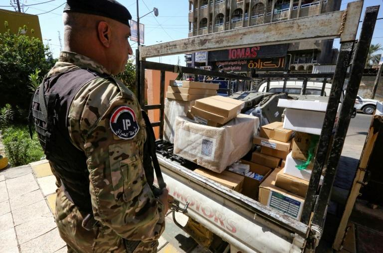 With the main political blocs linked to armed groups, many Iraqis are worried about security in the wake of the poll result (AFP/Sabah ARAR)