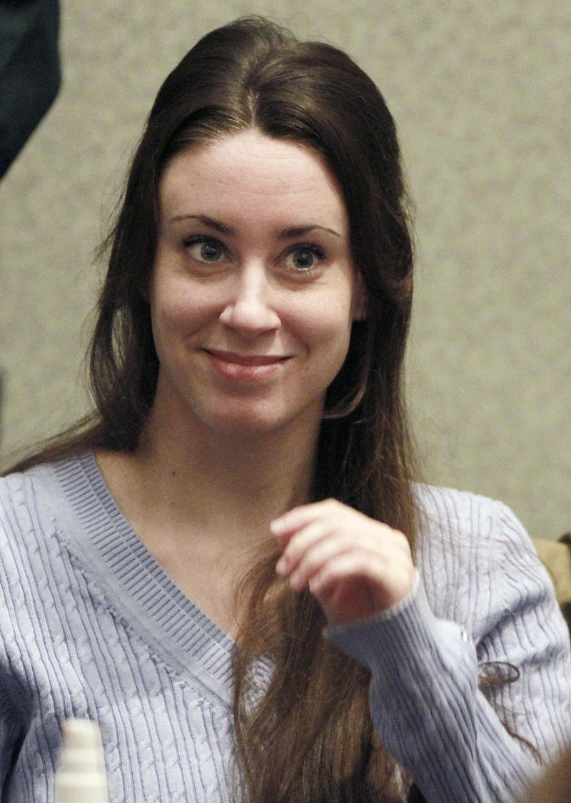 FILE - In this July 7, 2011 file photo, Casey Anthony smiles before the start of her sentencing hearing in Orlando, Fla.   Florida authorities say Casey Anthony reported Wednesday Aug. 24, 2011 to begin her one-year probation for 2010 check-fraud convictions.  (AP Photo/Joe Burbank, file)