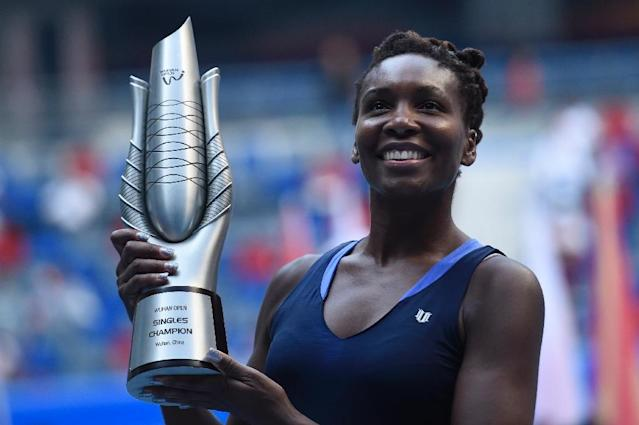 Venus Williams of the US poses with her trophy after winning the Wuhan Open tennis tournament in central China's Hubei province on October 3, 2015 (AFP Photo/Fred Dufour)