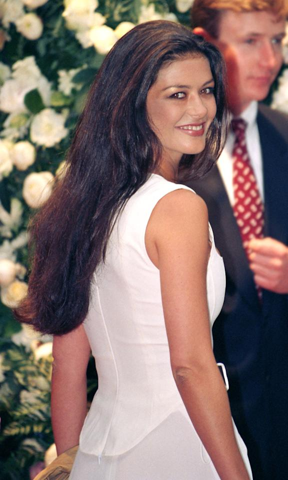 <p>Attending the A Gianni Versace Book Launch in London in 1995, Zeta-Jones wore her long locks swept back with a mauve lip.</p>