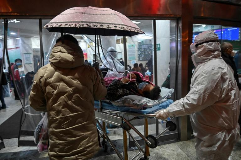 Medical staff in January 2020 wear protective clothing to help stop the spread of Covid-19 in Wuhan, China, where the virus was first detected