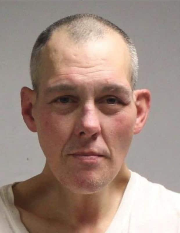 Yves Castonguay, 47, is wanted on a B.C.-wide warrant after failing to appear in court on charges of public incitement of hatred and mischief to property, the Vancouver Police Department said. (Vancouver Police Department - image credit)