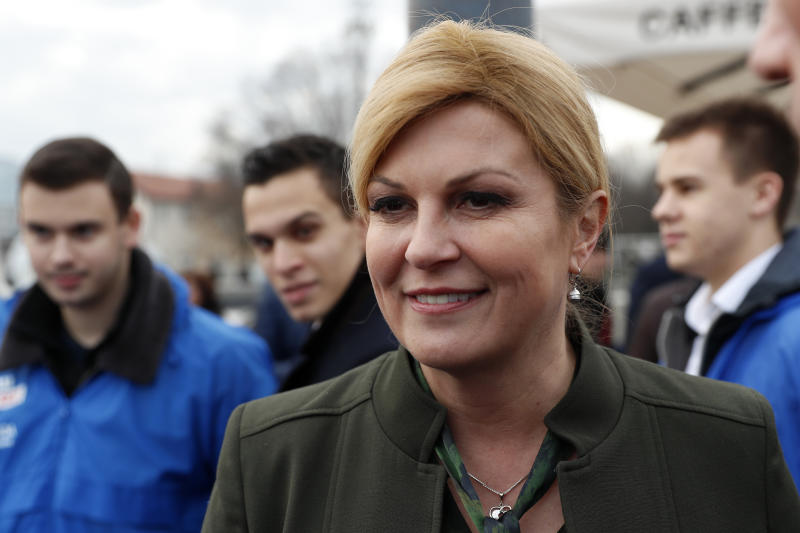 In this Thursday, Dec.19, 2019, file photo, incumbent president Kolinda Grabar Kitarovic greets supporters in downtown Zagreb, Croatia. Croatia's bitterly contested presidential race is headed for a finale this weekend to decide whether a conservative or a liberal will lead the country during its first ever chairmanship over the European Union. (AP Photo/Darko Bandic, File)