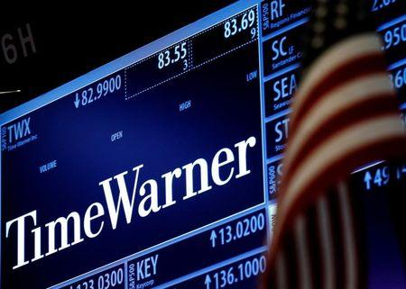 Ticker and trading information for media conglomerate Time Warner Inc. is displayed at the post where it is traded on the floor of the New York Stock Exchange (NYSE) in New York City, U.S., October 21, 2016.  REUTERS/Brendan McDermid