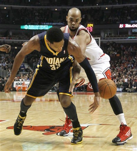 Chicago Bulls forward Taj Gibson, right, strips the ball from Indiana Pacers small forward Danny Granger during the first half of an NBA preseason basketball game Tuesday, Dec. 20, 2011 in Chicago. (AP Photo/Charles Rex Arbogast)