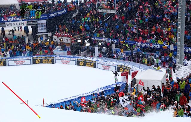 Bode Miller, of the US, speeds down the slope during a slalom portion of a men's alpine ski World Cup super-combined event, in Wengen, Switzerland, Friday, Jan. 17, 2014. (AP Photo/Alessandro Trovati)