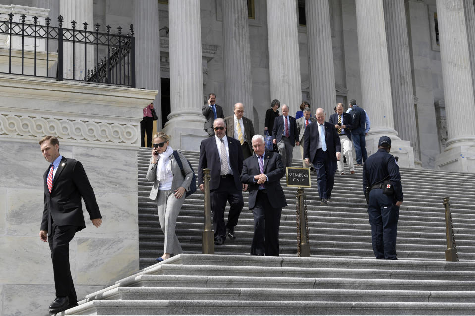 Members of the House of Representatives walk down the steps of Capitol Hill in Washington, Friday, March 27, 2020, after passing a coronavirus rescue package. Acting with exceptional resolve in an extraordinary time, the House rushed President Donald Trump a $2.2 trillion rescue package, tossing a life preserver to a U.S. economy and health care system left flailing by the coronavirus pandemic. (AP Photo/Susan Walsh)