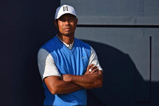 14-time major winner Tiger Woods much anticipated return to The British Open after a two year hiatus saw him shoot a level-par 71 hindered slightly by a painful neck (AFP Photo/Glyn KIRK)