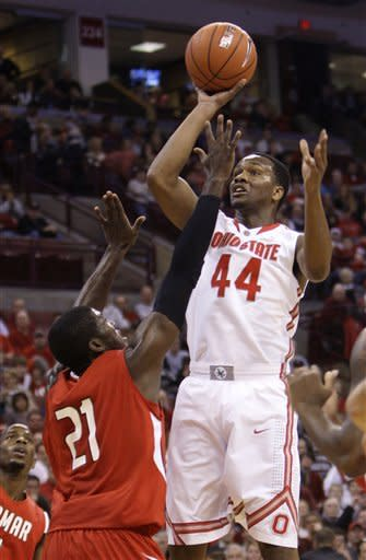 Ohio State's William Buford, right, shoots over Lamar's Charlie Harper during the first half of an NCAA college basketball game Tuesday, Dec. 20, 2011, in Columbus, Ohio. (AP Photo/Jay LaPrete)