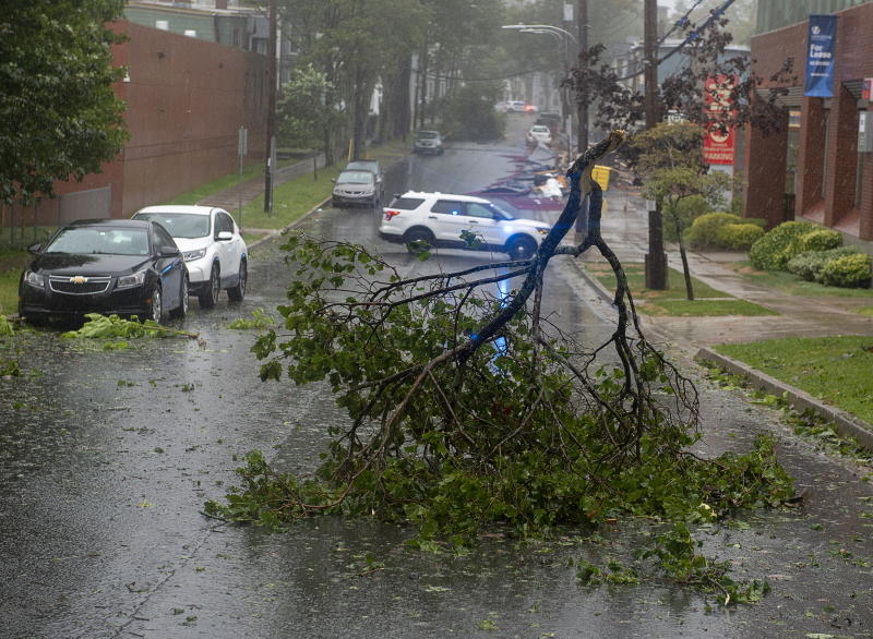 Tree branches block a street in Halifax, Nova Scotia as Hurricane Dorian approaches on Saturday, Sept. 7, 2019. Weather forecasters say Hurricane Dorian is picking up strength as it approaches Canada(Andrew Vaughan/The Canadian Press via AP)
